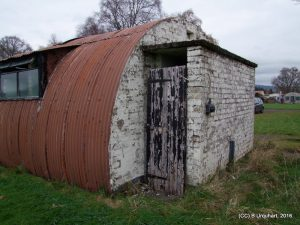 hut-48-ext-south-doorway-damage