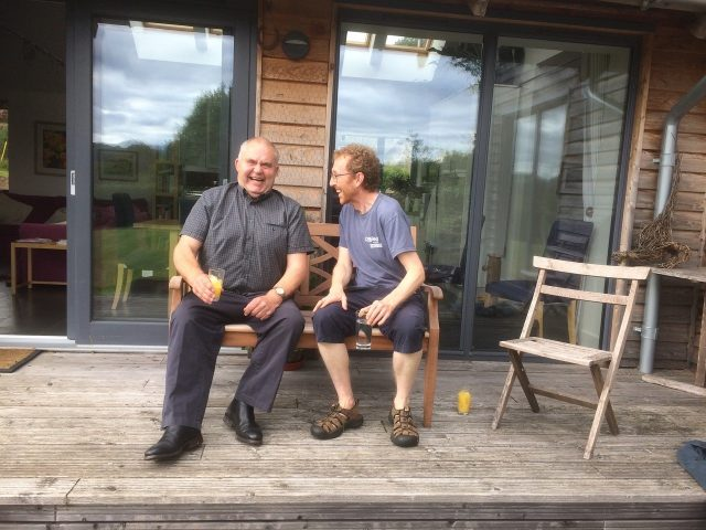 Photo attached of Alan & Davey enjoying the bench now installed in his garden! We gave him a thank-you card explaining the delay and who had contributed to the bench at the time.