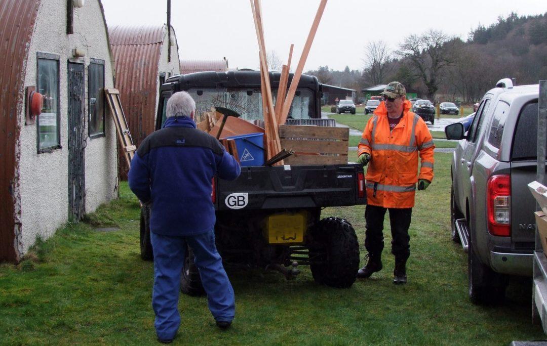 Volunteers load truck